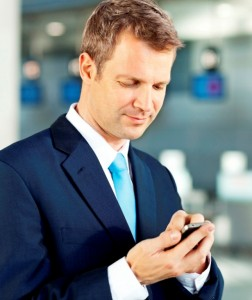 Businessman-in-airport-with-smartphone